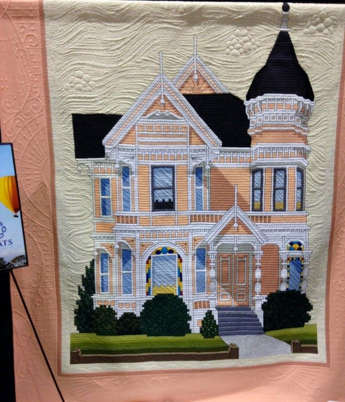 "This picture of the Victorian House was the best of show and it so deserved it.  Done in 1/2"" squares it was a reproduction of a cross stitch pattern! And the quilting was over the moon.  It was stunning."