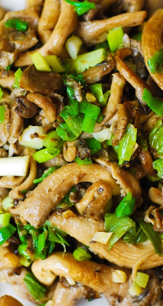 Oyster mushrooms sauteed with garlic, and topped with green onions. Vegetarian, vegan, gluten-free, paleo-friendly recipe.