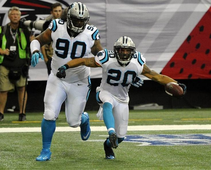 Carolina Panthers strong safety Kurt Coleman (20) celebrates his interception and touchdown against the Atlanta Falcons , as defensive tackle Paul Soliai (90) celebrates with him in the first half at the Georgia Dome in Atlanta, Ga. on Sunday, October 2, 2016. Atlanta won 48-33.