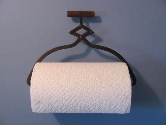 Antique ice tongs repurposed into towel holder