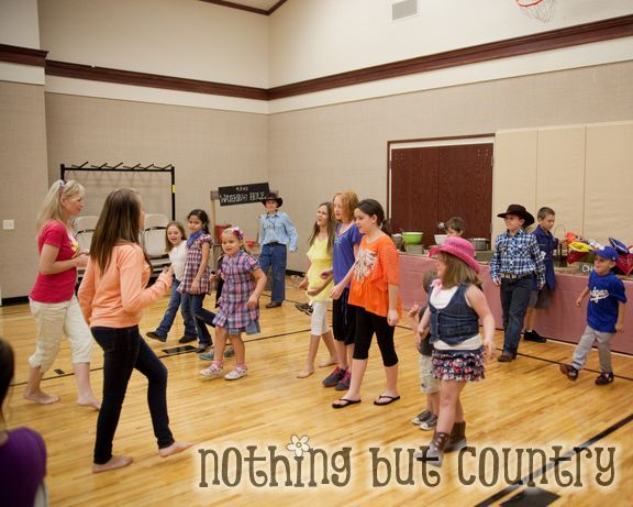 Line dancing a sweet Young Women in our Ward taught the kids how to line dance to Cotton Eyed Joe. That was a HUGE success!
