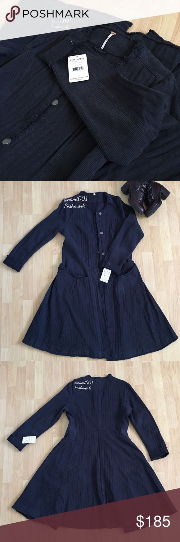 """Free People Duster Fit Flare Jacket Coat Dark Blue This chic flare jacket from Free People has a little bit of that military meets rocker edgy look. Brand new with tags. The flare will instantly slim you. Front buttons with front slip pockets. Made of denim material with stretchy cotton spandex mix material on the sides. Hem has even frays. Measures: 20"""" underarm to underarm. 38"""" shoulder to hem. Make a bold statement with this fashionista jacket. Wear with skinny jeans or mini, either way…"""