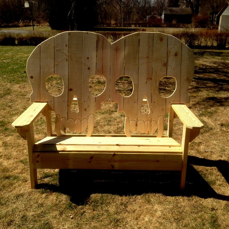 This is a double all wood skull bench, which is basically two of our skull chairs together as one bench. It can support over 600 lbs, as in the last picture with the two big guys on it. It features an all wood construction as well as pressure treated decking which is over an inch thick (5/4 s