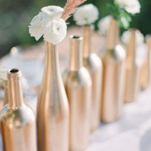 Reception Decor: Budget cuts: DIY: spray paint wine bottles with rose gold spraypaint. Not too many, just for accent colors!