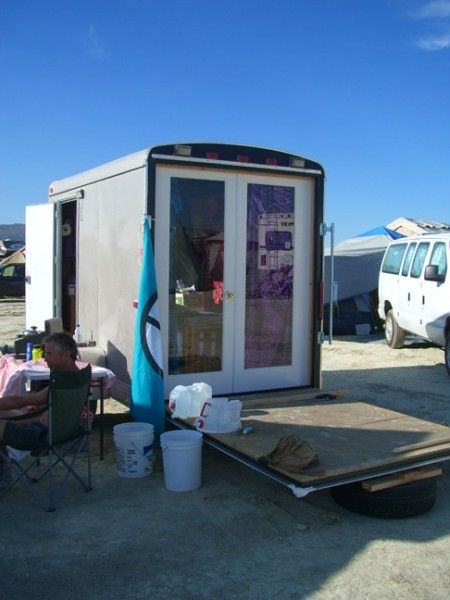 Our neighbor converted a toy hauler into a tiny shelter with French doors