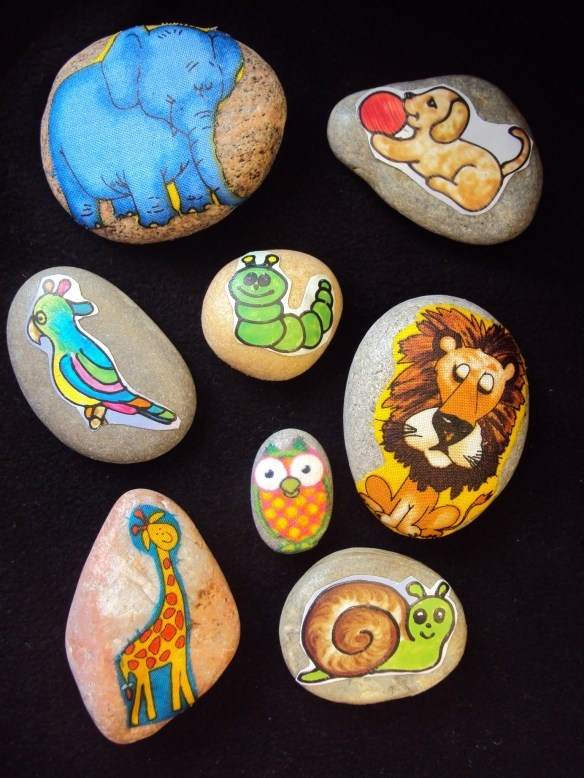 Story Stones. This blog tells exactly how she made them and the materials she used from fabric to pages from craft books using Mod Podge. She also recommends trying it with stickers and varnish.