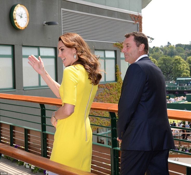 The Duchess of Cambridge was accompanied to her seat in the Royal Box by the Chairman of the All England Lawn Tennis Club, Philip Brook who also showed the Duchess of Cornwall around last week