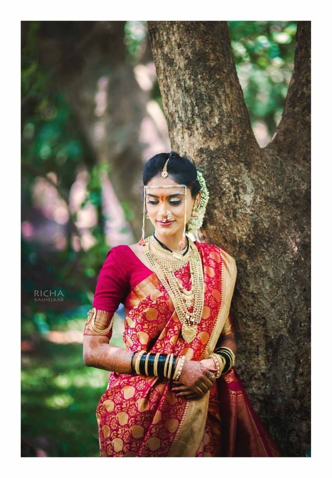 Indian maharashtrian bride wearing bridal saree / sari and jewelry. #BridalHairstyle #BridalMakeup #MaratiBride