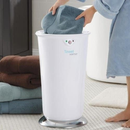 """Promising Review: """"We use this every morning and love it. Compact enough to fit in the corner behind the door, great timer function, safe, and attractive. It works very well, heating two large bath towels through and through, so it makes getting out of the shower feel luxurious."""" —Charlene K.Get it on Amazon for $102.95."""