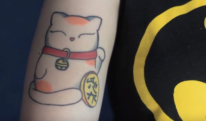 Lucky cat tattoo. Geek.