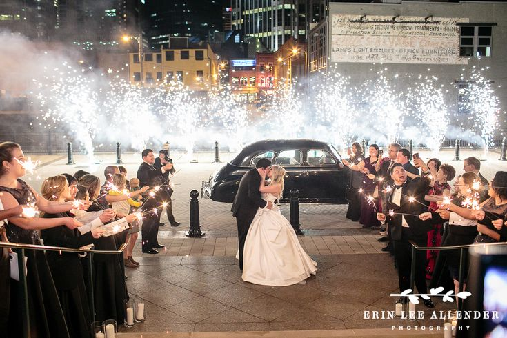 A glamorous red and black winter wedding at The Schmerhorn Symphony Center and Wightman Chapel Scarritt ...