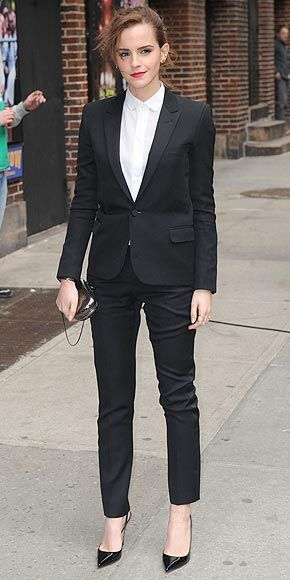 a single-button blazer and slim-fit trousers from Saint Laurent, a silver Reese Hudson clutch, and Louboutins (march 2014)