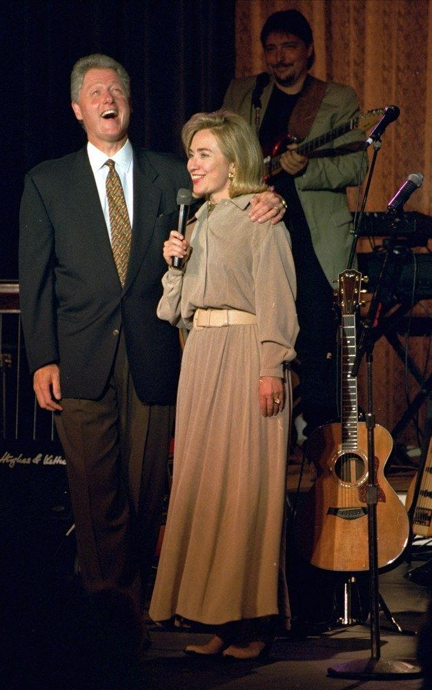 """President and Mrs. Clinton laugh during the introductions of a concert Wednesday night, May 17, 1995 on the South Lawn at the White House. The concert was being taped for a PBS television series ""In Performance at the White House."" The hour-long performance, featuring the women of country music, was hosted by Chet Atkins."""