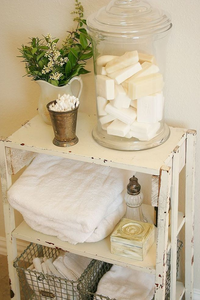 Making Toiletries part of your Bathroom Decor. - I got this little shelf/table at Roundtop Antiques Show Lat year for $20. I love the look of stacked white towe…