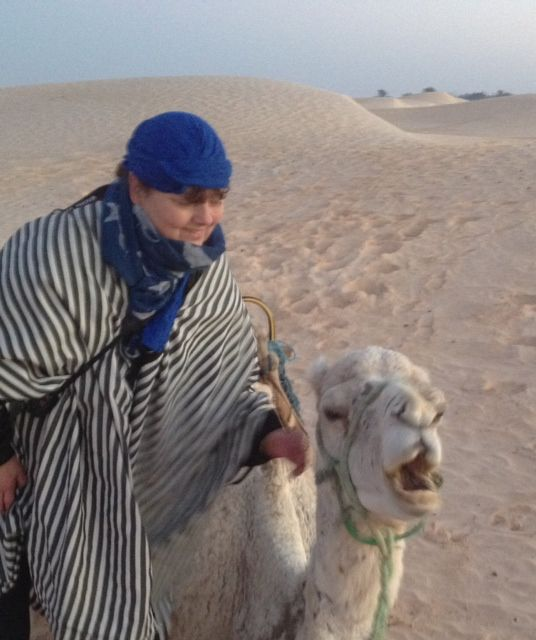 Me on a camel - a beautiful white lady!