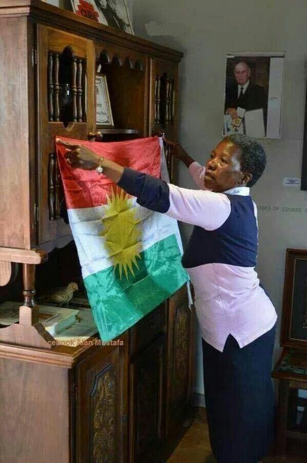 Nelson Mandela's Wife proudly hanging kurdish Flag in solidarity with kurdish women freedom fighters.