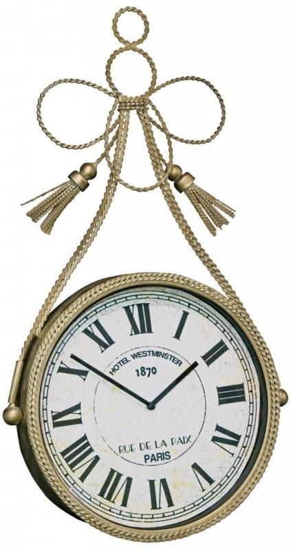 A stunning French cream wall clock. This lovely wall hanging metal clock has an elegant braided detailed tassle design complete with a white crackled round