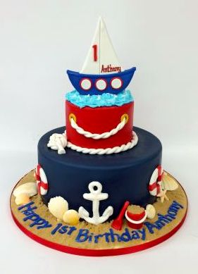 This first birthday cake is setting sail!