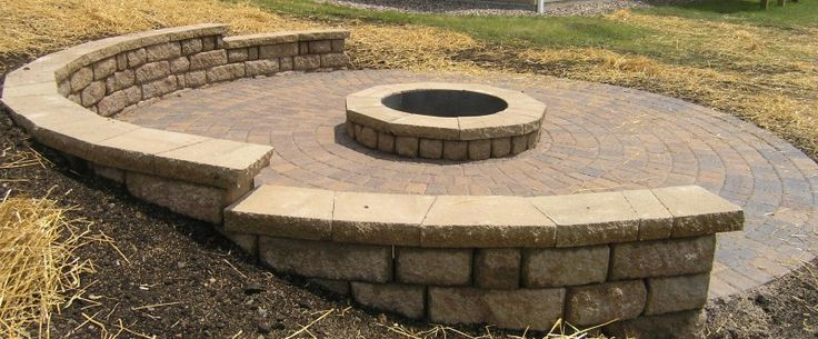 Fire pit on a slope but use pea gravel instead of brick for Gravel around fire pit