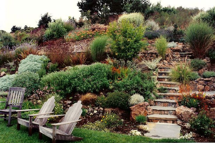 beautiful hillside garden design by Farnsworth Landscaping.  I'd turn the chairs around and admire the garden!