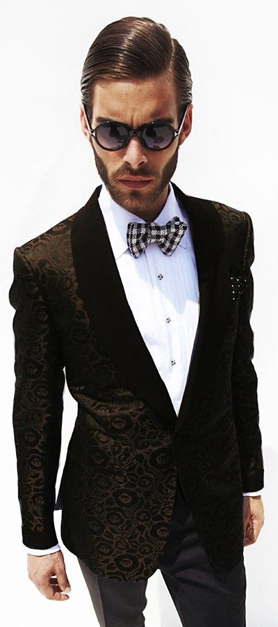 this man scares me a little. I know it's the lens, but if I saw him in real life, I'd run :0  but I do like bow ties :)