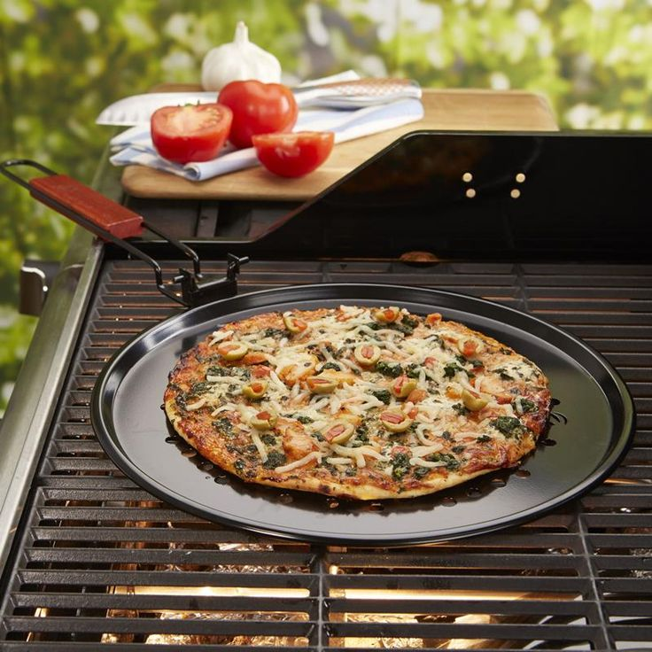 The Outset BBQ Non-Stick Pizza Pan is the perfect way to make pizza on a hot summer day.
