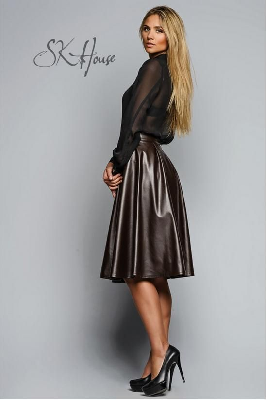 Long flared faux leather skirt, black see-through long-sleeve blouse, and black high heels round out this outfit by designer SK House.