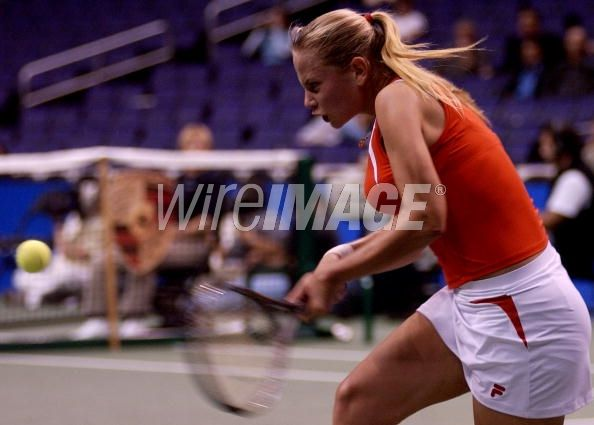 Jelena Dokic of Yugoslavia returns...