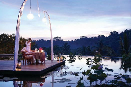 Romantic dinner by the pond at Four Seasons Resort Bali at Sayan, Ubud. Photo courtesy of Four Seasons Resort via The Ja...