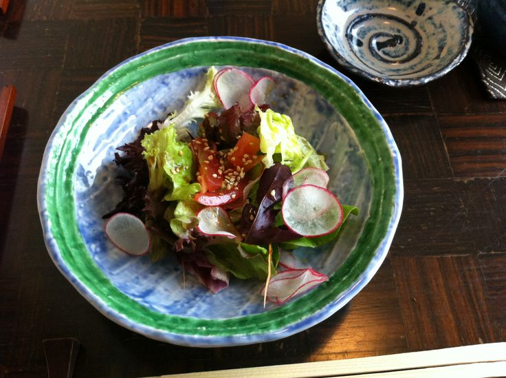 Salad with sliced radish in a sesame japanese dressing