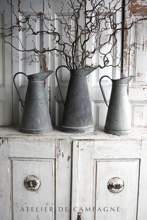 Atelier de Campagne ! Love these twigs in the pitchers....good look...simplicity at its best.... More