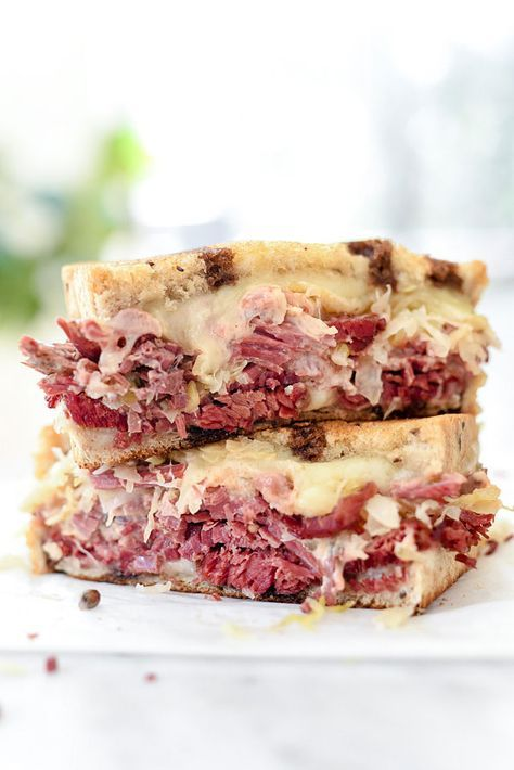 My favorite part of making corned beef is making reuben sandwiches piled high with swiss cheese, sauerkraut and Russian dressing #sandwich #stpatricksday | foodiecrush.com