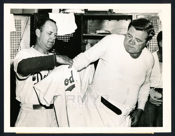 He's officially a Dodger now.   Featured above is a vintage International News press photograph showing the Dodgers manager helping newly signed Dodgers coach, Babe Ruth, into his uniform for the very first time.