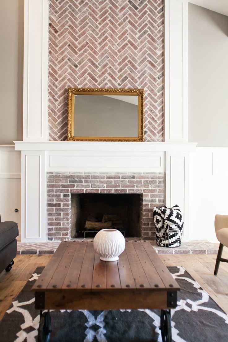 Custom fireplace with herringbone brick work by rafterhouse rafterhouse interiors - Fireplace finish ideas ...