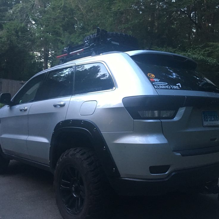 Lifted wk2 Jeep Grand Cherokee kumho tires blacked out