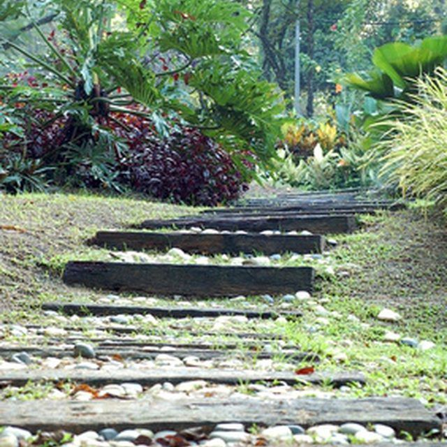 Railroad tie steps are a great way to add contour to your landscaping.