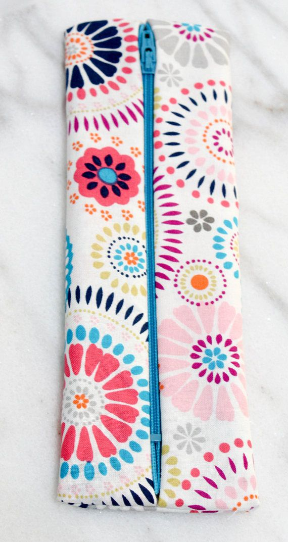 This pink and blue floral print brush bag can brighten any bathroom counter! Store your brushes or toiletry items inside this fully lined bag. Small enough to fit into any carry-on, backpack or purse, this pink and blue floral brush bag can carry your brushes easily and protect them from dirt.  PERFECT FOR:  • Bridesmaid Gifts • Birthday Gifts • Sorority Gifts • Just Because Gifts • Travel/Graduation Gifts  MEASUREMENTS:  11 x 3 inches  ADDITIONAL INFO:  Care Instructions included with e...