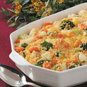 CHEESY VEGETABLE GARDEN BLEND} Steam 2 – 12 oz. bags frozen GARDEN VEGETABLE BLEND; Put 1/2 vegetables in buttered shallow oven safe dish; Shred 4 oz. MOZARELLA & 8 oz. CHEDDAR cheeses, mix; Sprinkle on vegetables; Repeat, TOPPING: Mix 4 T. BUTTER, melted; envelope BUTTER CRACKERS, crushed; Sprinkle on top; Bake uncovered 325°15 - 20 min.