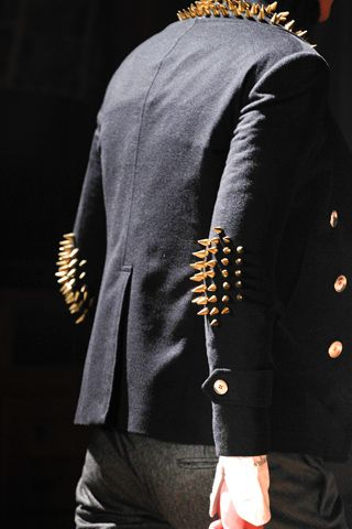 Spiked collar & sleeve patch jacket.