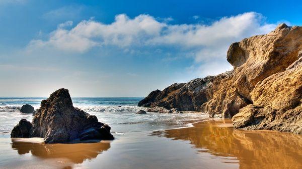 beach rocks skies malibu sea 2560x1440 wallpaper