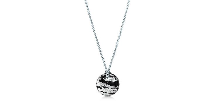 Elsa Peretti® Round pendant of snowflake obsidian and sterling silver.