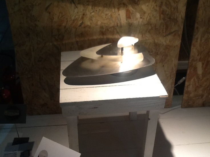 Onyx . Iron and Onyx Lamp. Its asymmetrical curves which allow the light to gently filter through are inspired by nature.This lamp gives off a soft light creating a sophisticated atmosphere.