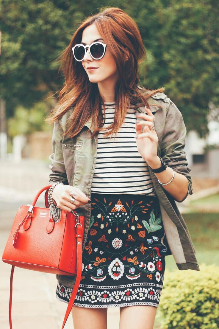 Spring outfit wearing a gorgeous embroidered skirt. Mixing prints and colours with a striped top, military green parka and red bag.