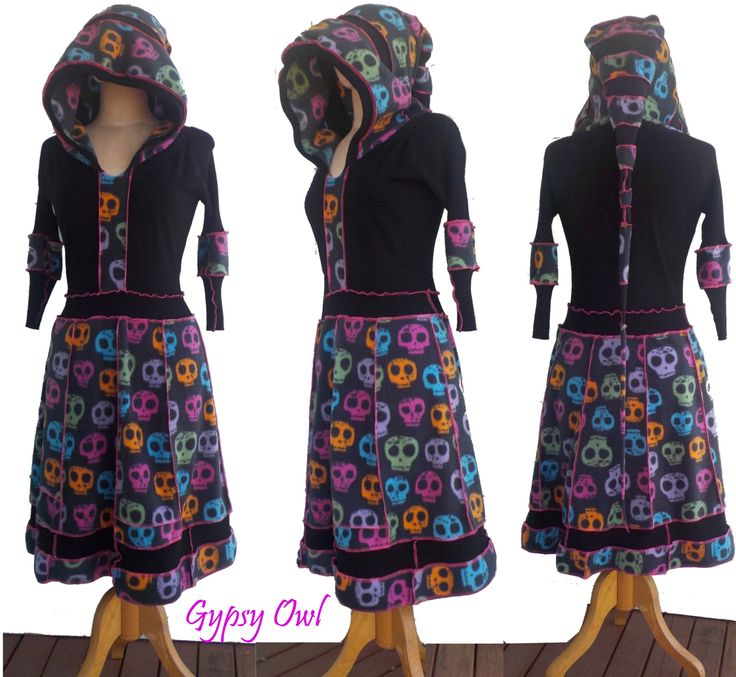 'Whimsical' is an up-cycled woman's dress, handcrafted from re-purposed fabrics featuring colourful skulls and an amazing flowing hood...!