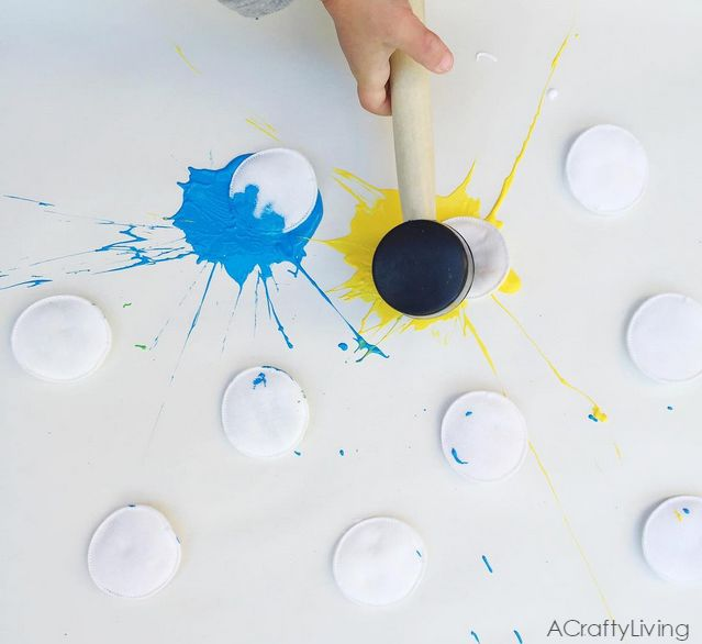 Do this color splat art activity with your kids using paint, cotton rounds, and a rubber mallet!