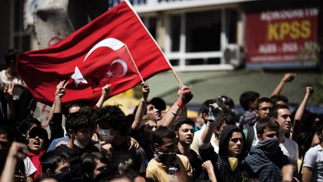 Protestors waving the flag during protests in Ankara on June 4.