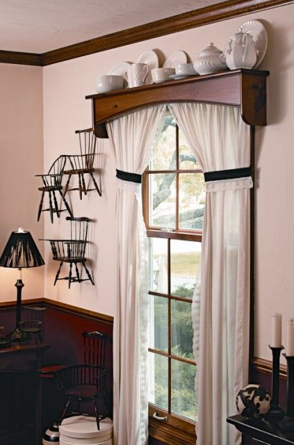 Wood valances and mini chairs decorate the room.