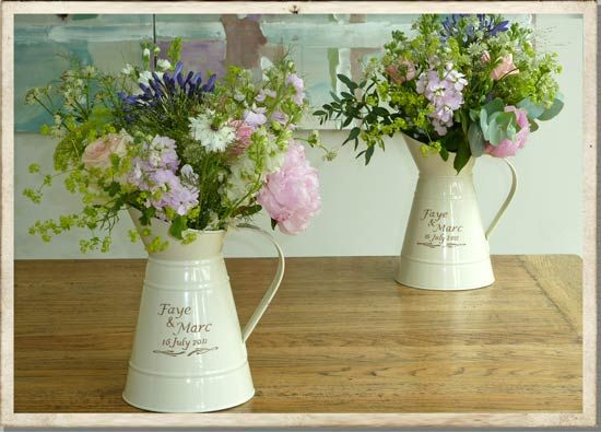 Table centres will look similar to this minus the personalised jugs
