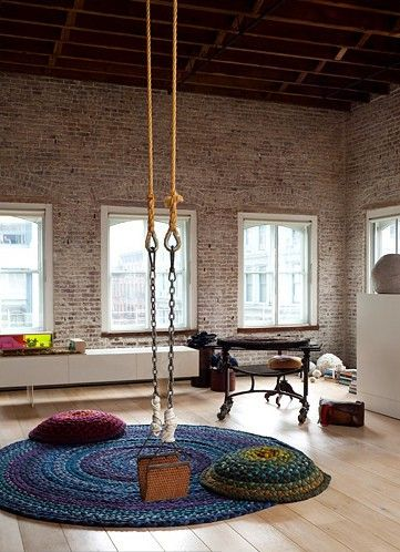 SO FLIPPIN AWESOME!!! I want a living room like this. Living in an old warehouse is a dream I had since I was little. A swing in the living room gives it even more brownie points.