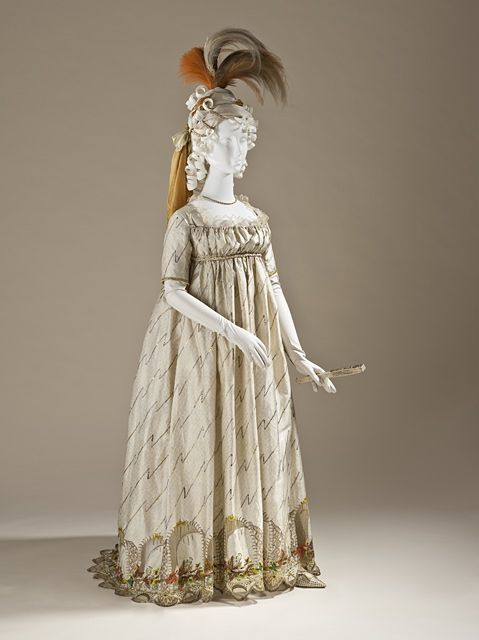 Embroidered and sequined silk dress, European, c. 1795 (textile c. 1785-90). Silk plain-weave with weft-float patterning, silk and metallic-thread embroidery, sequins, silk and linen net, and silk plain-weave (faille) trim.